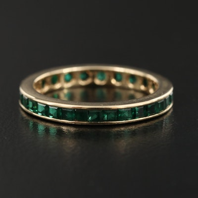 14K Channel Set Emerald Eternity Band