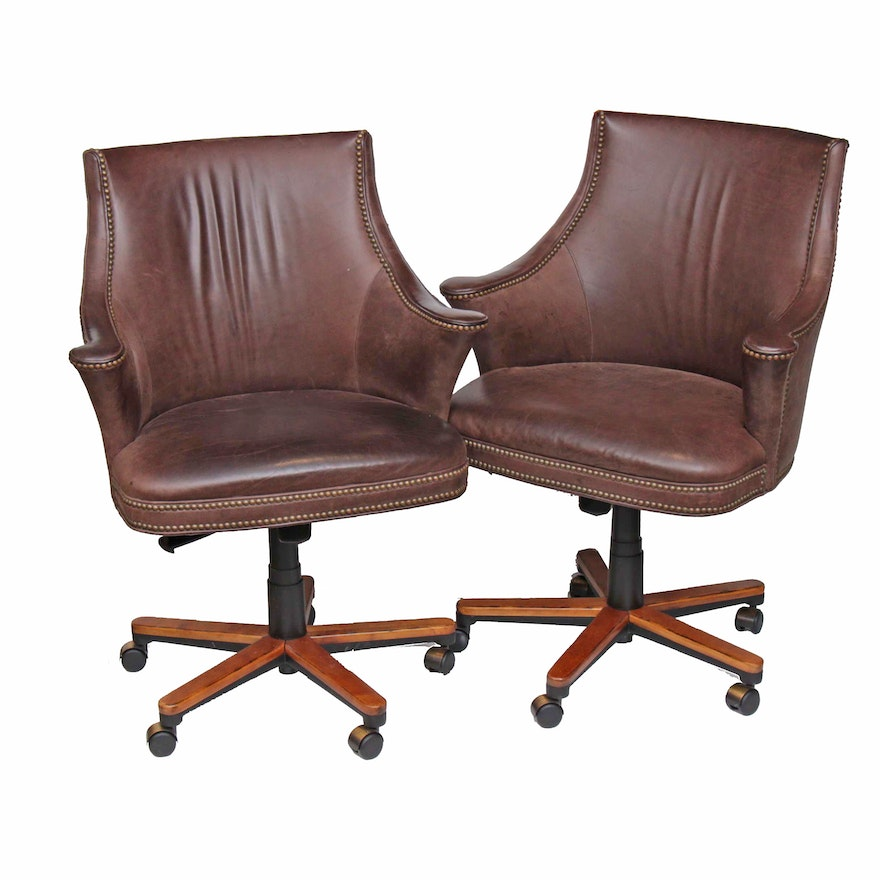 Pair of Aged Leather Adjustable Swivel Chairs with Nailhead Trim