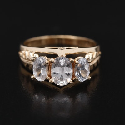 14K Sapphire Ring Featuring Leaf Shaped Shoulder Accents