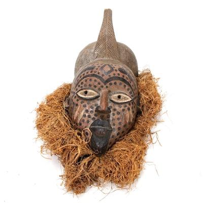 Yoruba Polychrome Helmet Mask with Raffia, Nigeria