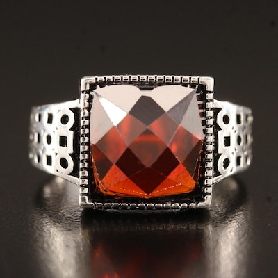 Sterling Silver Garnet Ring Featuring Geometric Shoulder Designs