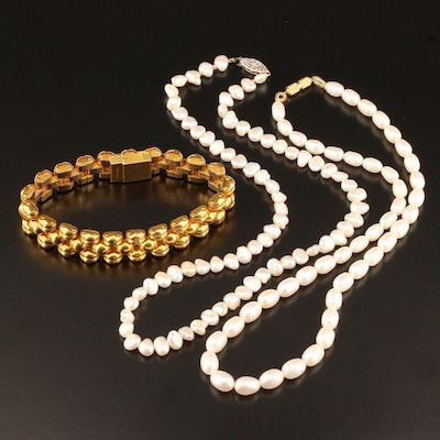 Oval and Baroque Pearl Necklaces with a Swiss Panther Link Bracelet