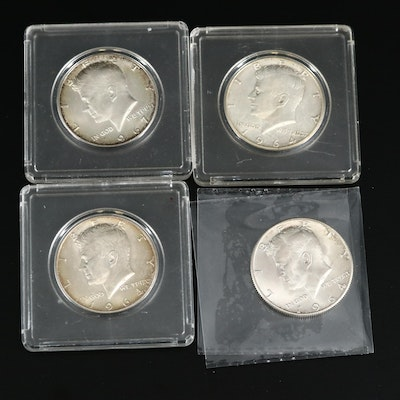 Four Kennedy Silver and Silver-Clad Half Dollars