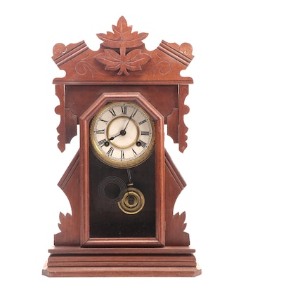 New Haven Clock Co Walnut Gingerbread Clock, Late 19th to Early 20th Century