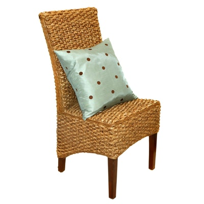 Woven Seagrass Accent Chair and Feather Throw Pillow