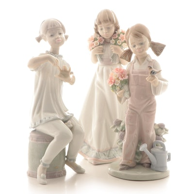 "Lladró ""Spring Girl"", ""Girl Manicuring"", and ""Spring Bouquets"" Figurines"