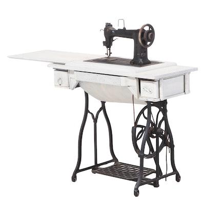 Wheeler & Wilson Mfg. Co. Painted Oak and Cast Iron Treadle Sewing Machine
