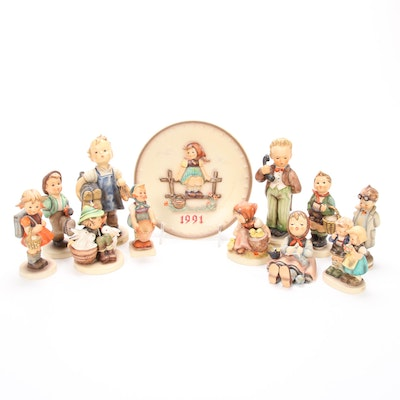 "Goebel Hummel Figurines Including ""Hello"" and ""Boots"""