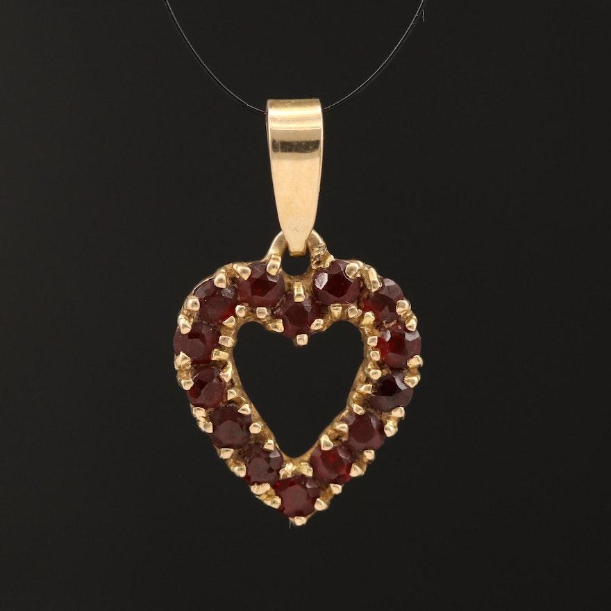 14K Open Heart Pendant Lined with Garnet