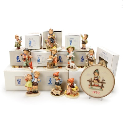 "Goebel ""Farm Boy"" and Other Porcelain Hummel Figurines with Plate"