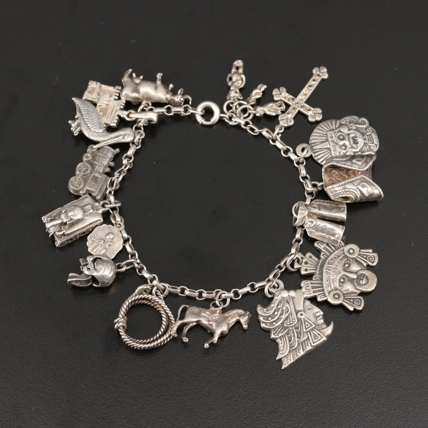 Sterling Silver Charm Bracelet Including Articulated Skull and Cross
