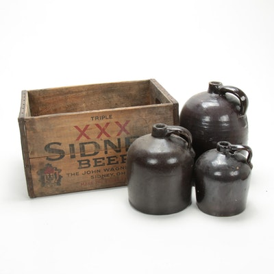 Brown Glazed Stoneware Whiskey Jugs in Wooden Beer Crate, Late 19th/Early 20th C
