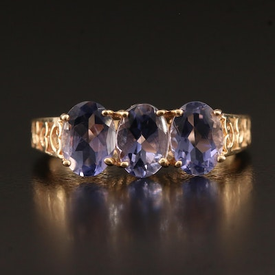 10K Tanzanite Ring Featuring Scroll Patterned Gallery
