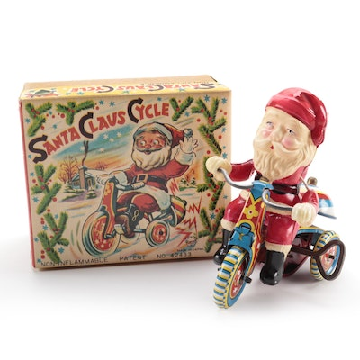 Santa Claus Cycle Windup Tin Lithograph and Celluloid Toy in Original Packaging