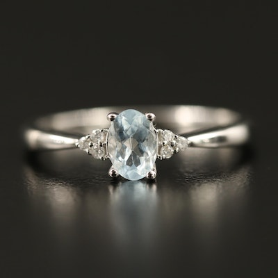 10K Aquamarine Ring with Pinched Shoulders and Diamond Accents