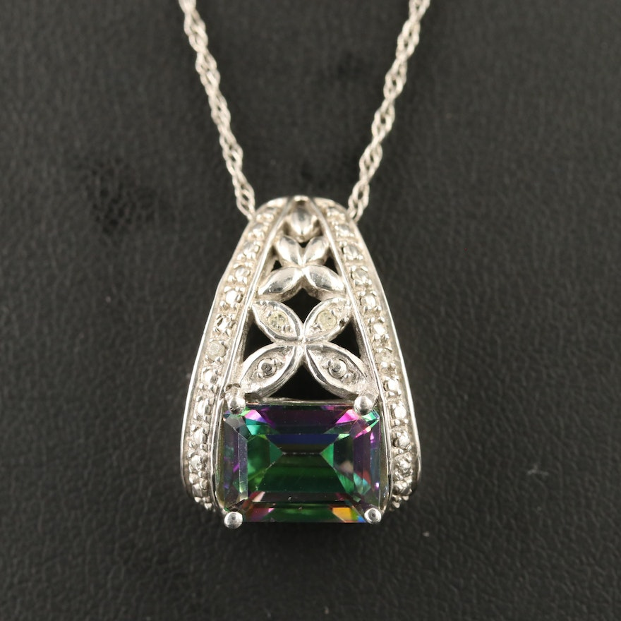 Sterling Silver Topaz Pendant with Diamond Accents