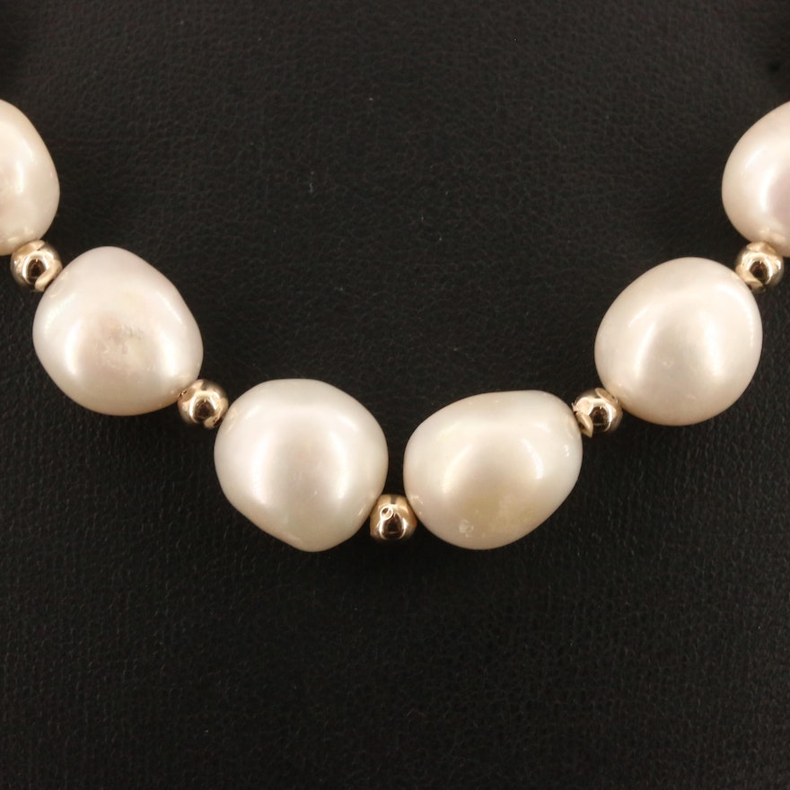 Strand of Oval Semi-Baroque Pearls with 14K Findings