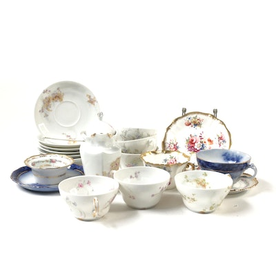 Theodore Haviland Porcelain and Other Floral Teacups, Saucers, and Creamer