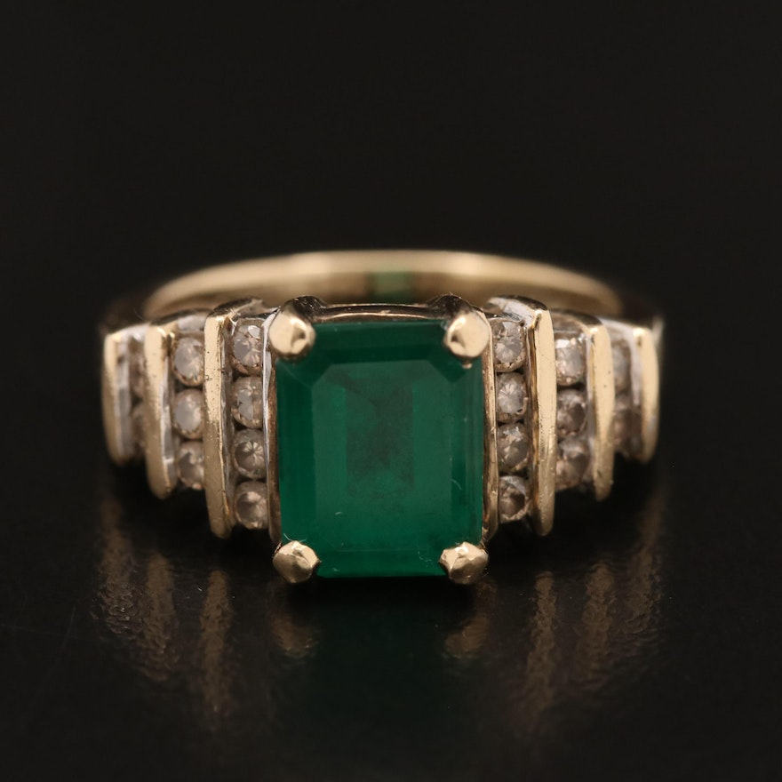 10K Emerald Ring with Stepped Diamond Lined Shoulders