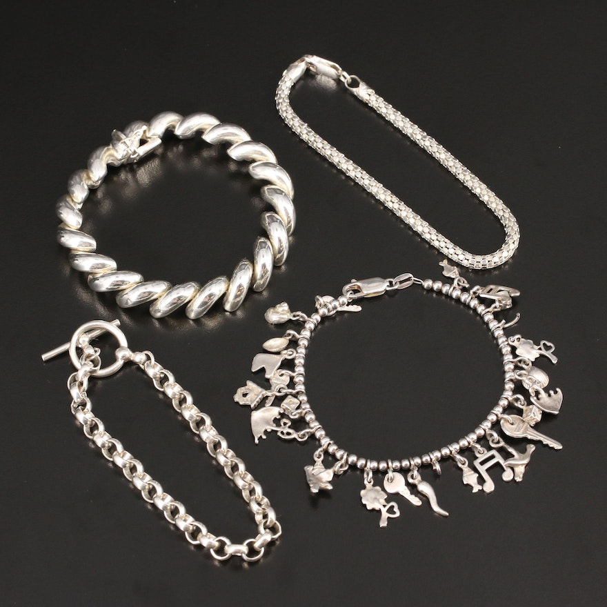 Assorted Sterling Silver Bracelets Featuring Charm Bracelet