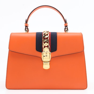 Gucci Medium Sylvie Two-Way Top Handle Bag in Orange Leather