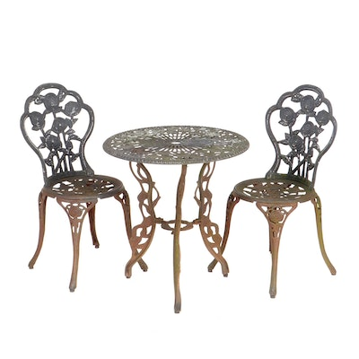 Victorian Style Three-Piece Rose Motif Cast Iron Patio Chair and Table Set