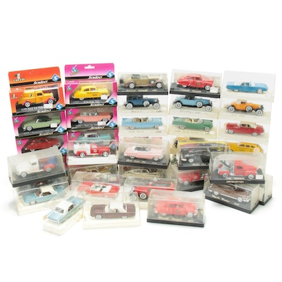 Forty Solido Diecast Model Cars Including Cadillac Convertibles, Taxis, and More