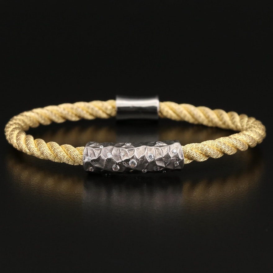 Sterling Silver Twisted Style Bracelet with Cubic Zirconia Accents