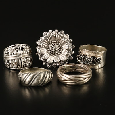 Assorted Sterling Rings Featuring Or Paz Israeli Silver and Floral Designs
