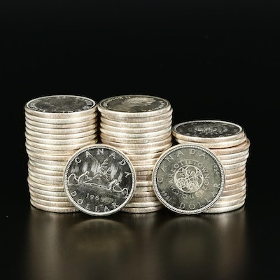 Fifty-Four Uncirculated Canadian Silver Dollars, 1964 and 1965