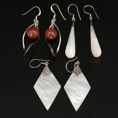 Assorted Sterling Silver Earrings Featuring Mother of Pearl and Goldstone Glass