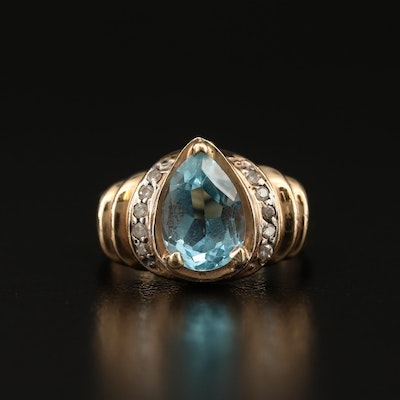 14K Topaz and Diamond Ring Featuring Ribbed Shoulders