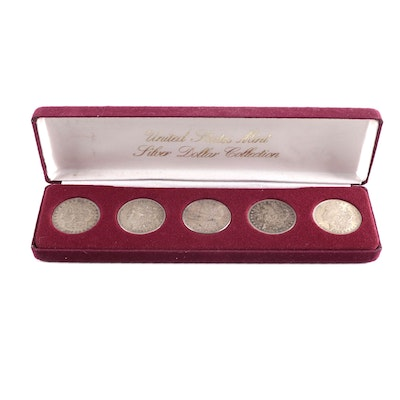Five Morgan Silver Dollars with Case, Late 19th/Early 20th Century