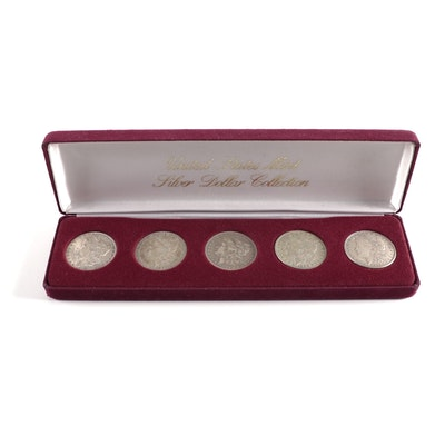 Five Morgan Silver Dollars with Case