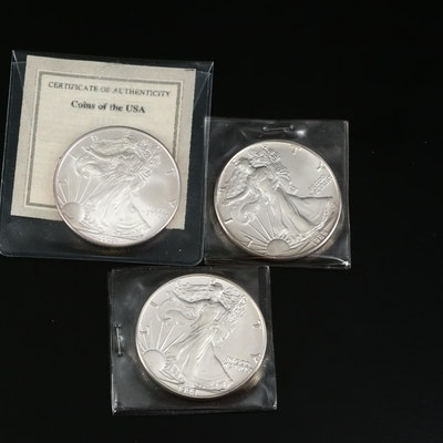 Three Silver Eagle Bullion Dollar Coins, 1988 and 2009