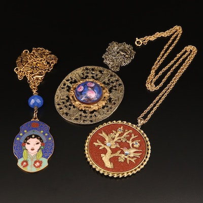 Assortment of Pendant Necklaces Featuring Goldstone and Enamel