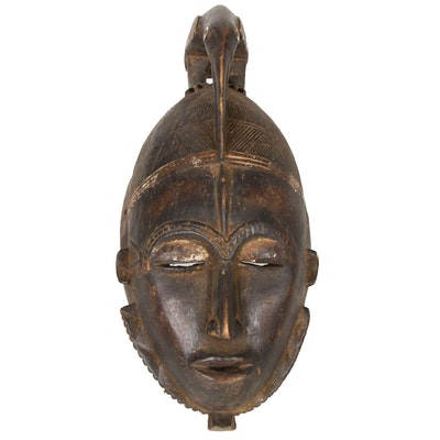 Guro Style Carved Wood Mask with Hornbill Motif, Côte d'Ivoire