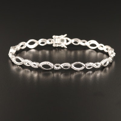 Sterling Silver Diamond Link Bracelet with Twisting Design