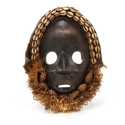 Dan Wooden Mask with Cowrie Shells and Embellishments, West Africa