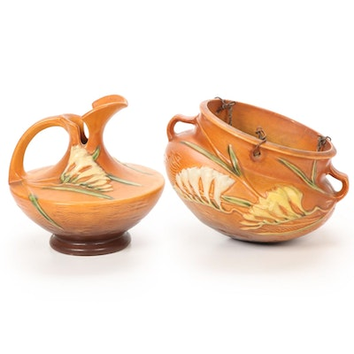 """Roseville Pottery """"Freesia Tangerine"""" Hanging Planter and Pitcher, 1940s"""