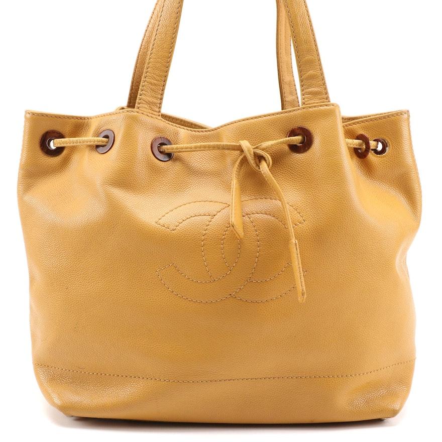 Chanel CC Drawstring Bucket Bag in Mustard Yellow Caviar Leather