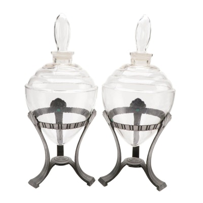 Pair of Lidded Glass Vessels with Metal Stands