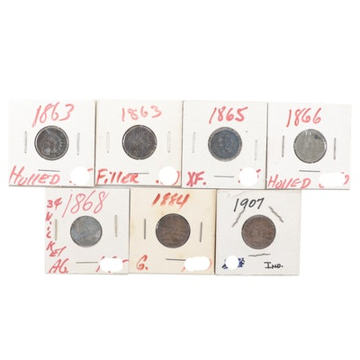 Four Indian Head Cents and Three Liberty Head 3-Cent Coins