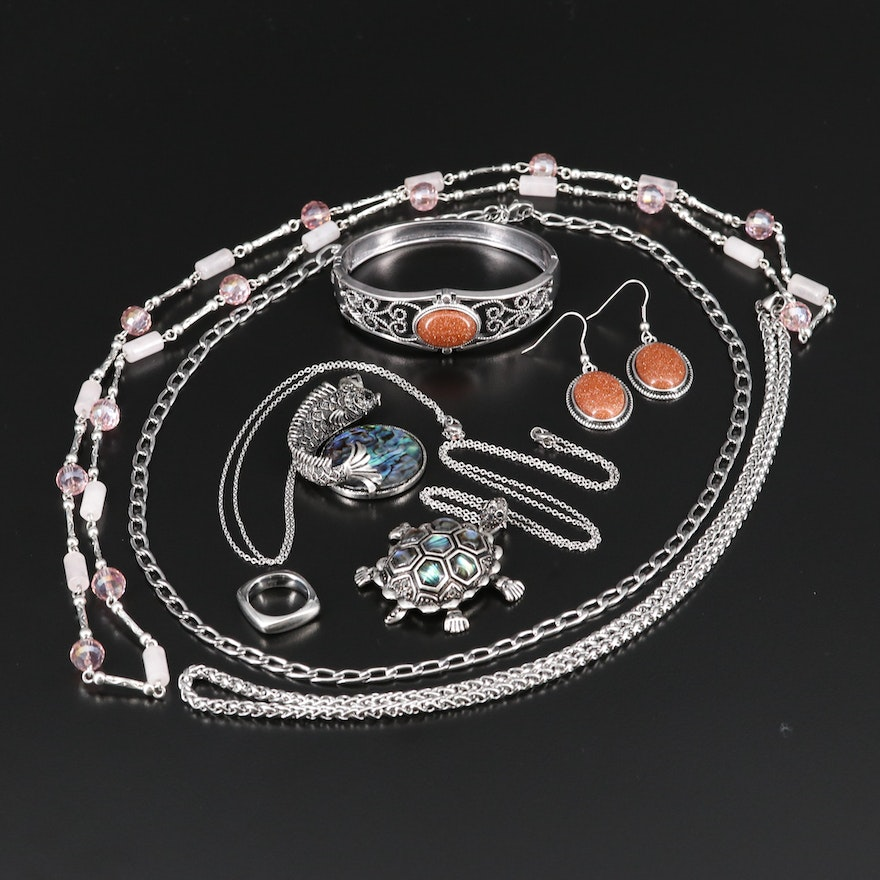 Selection of Jewelry Featuring Necklaces, Cuff, Ring and Earrings