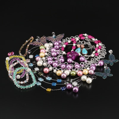 Selection of Jewelry Featuring Necklaces, Earrings, and Bracelets
