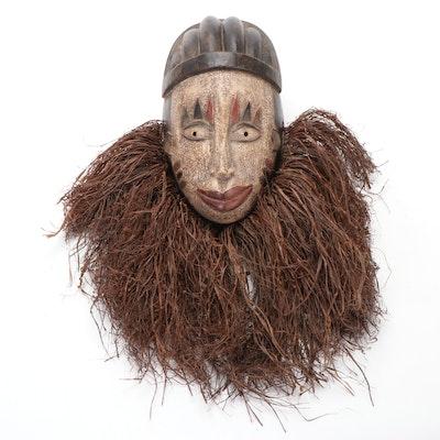 Yoruba Polychrome Wooden Mask with Raffia Collar, Nigeria