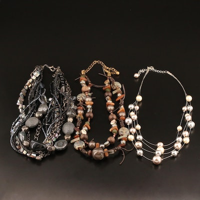 Assortment of Necklaces Featuring Pearl, Mother of Pearl and Wood