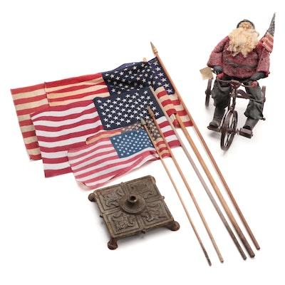 Elaine M. Slack Santa Figurine, Cast Iron Holder, and American Flags