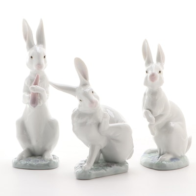 "Lladró ""Hippity Hop,"" ""Washing Up,"" and ""Snack Time"" Porcelain Rabbit Figurines"