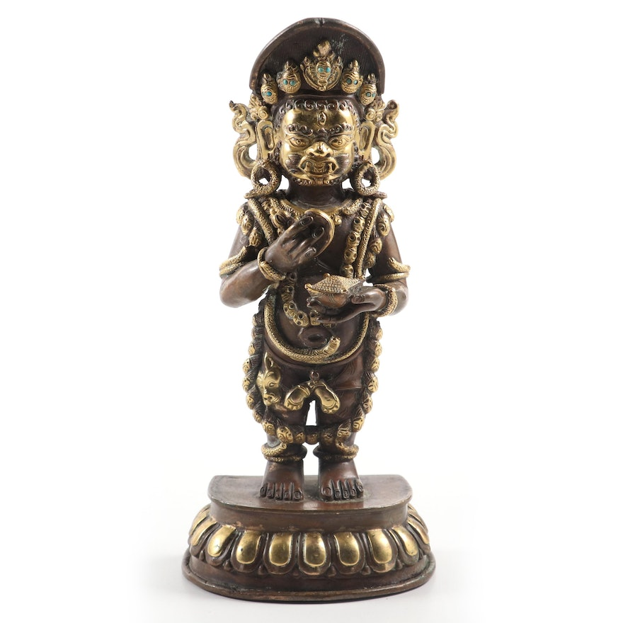 Himalayan Two-Armed Mahakala Parcel Gilt Copper Figure with Turquoise Inlay